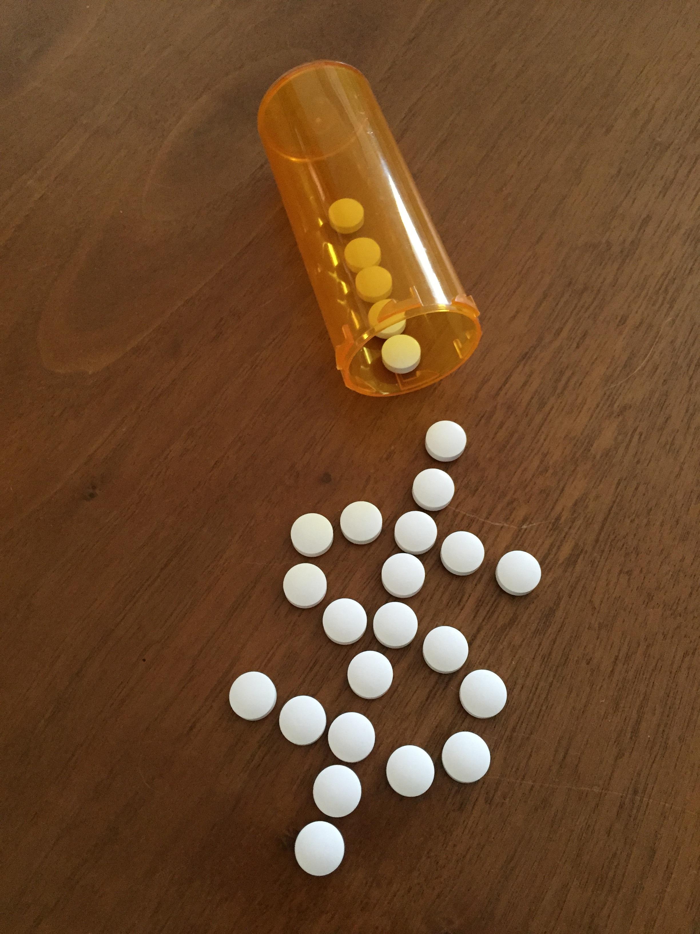 pills in dollar sign